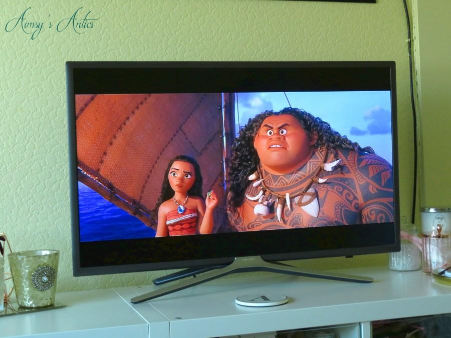 TV screen showing Moana and Maui