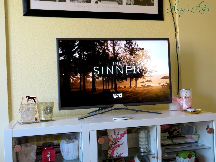 TV screen displaying the sinner title sequence