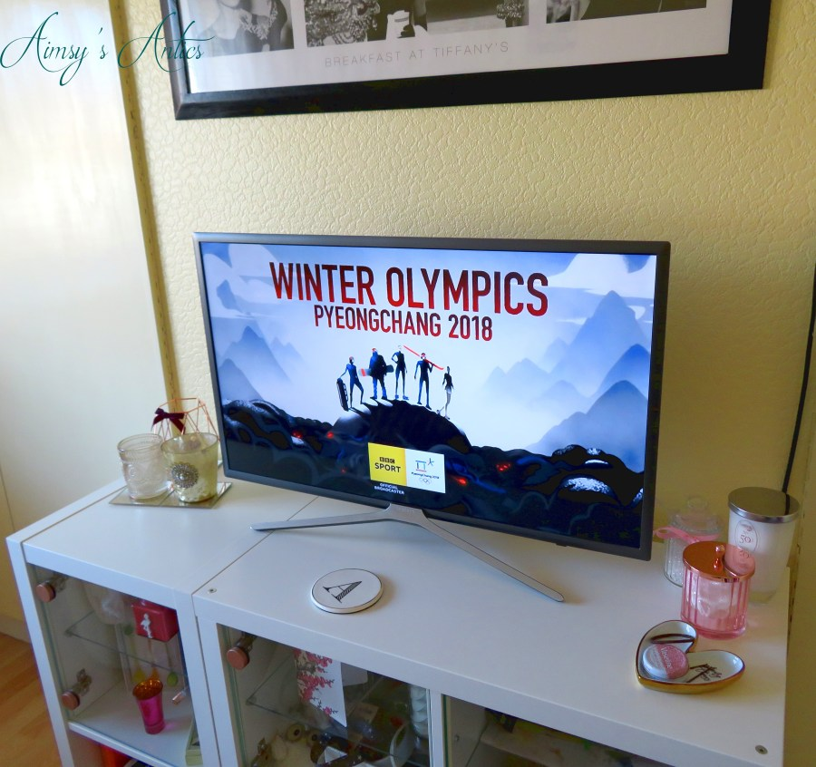 TV screen displaying the winter Olympics title sequence