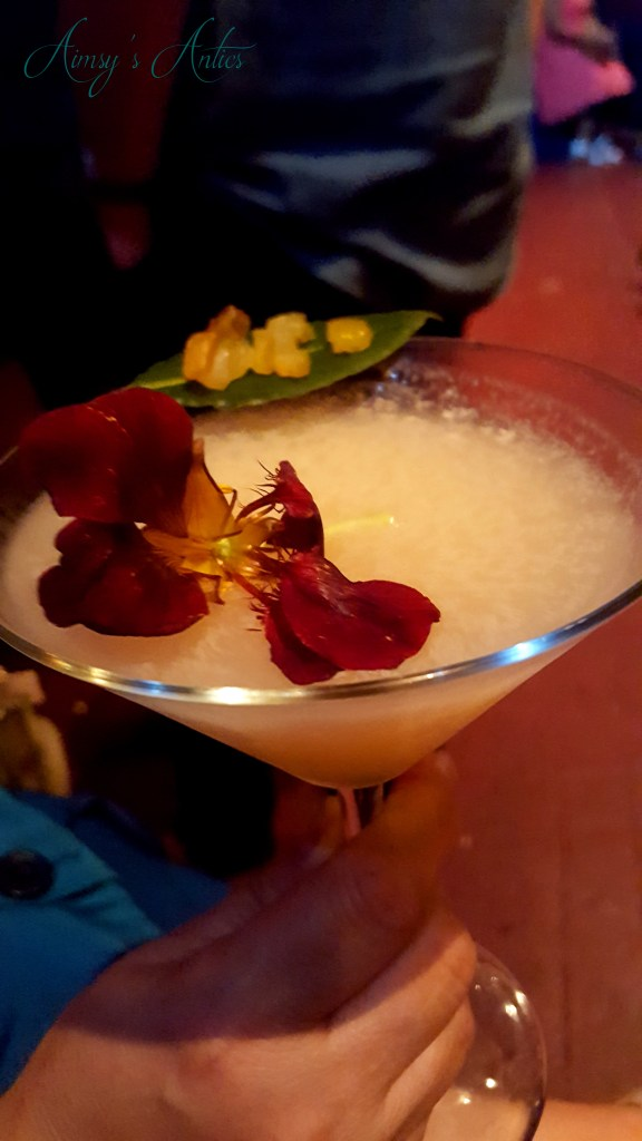 Image of Cocktail with flower and leaf decoration