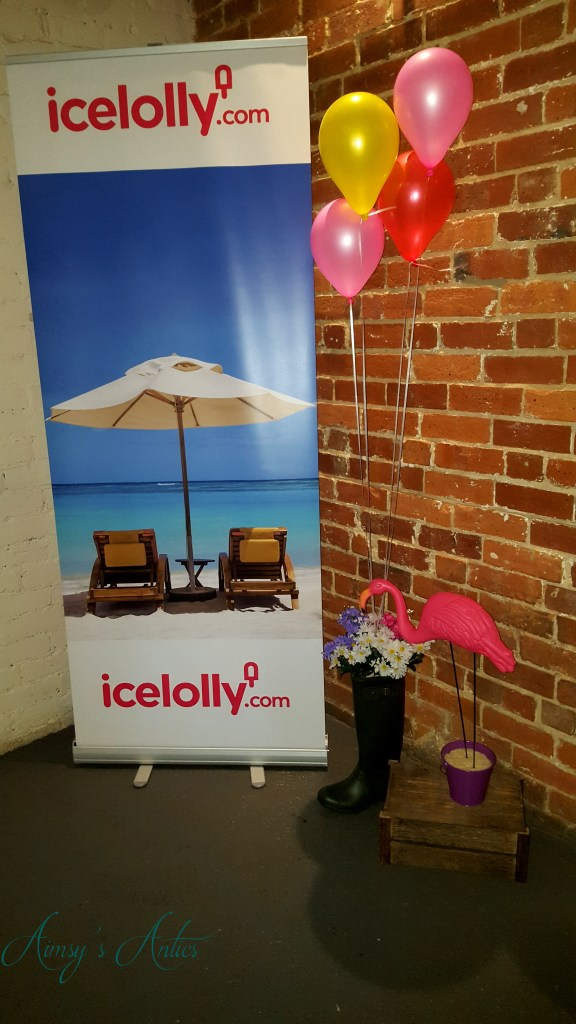 Image of Blog at the beach event decor - Ice lolly holidays banner, balloons and a flamingo