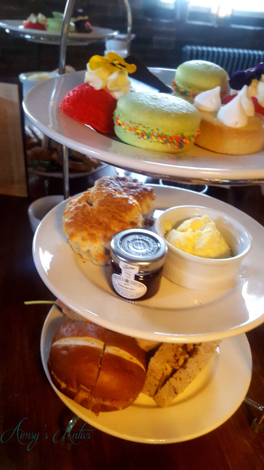 Afternoon tea cake stand with sandwiches, scones and desserts