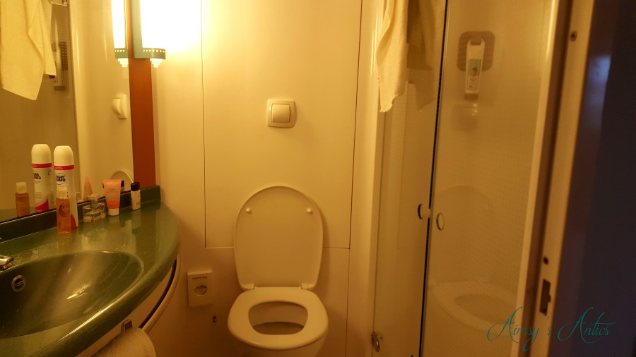 Image of a bathroom at the Ibis Hotel Leeds. Sink, toilet and shower in shot