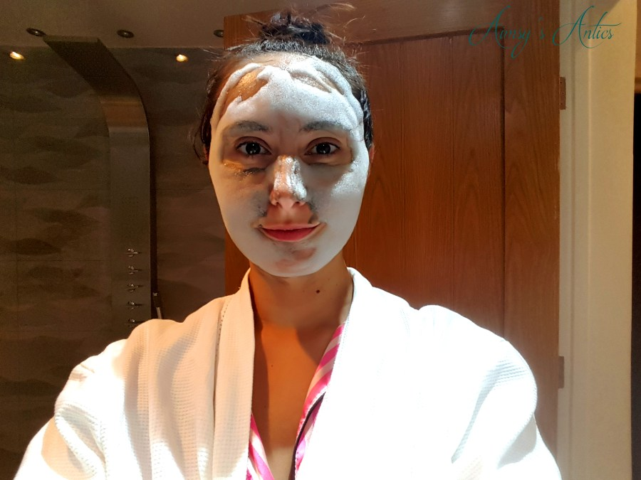 Image of a selfie of a woman with bubble face mask on.
