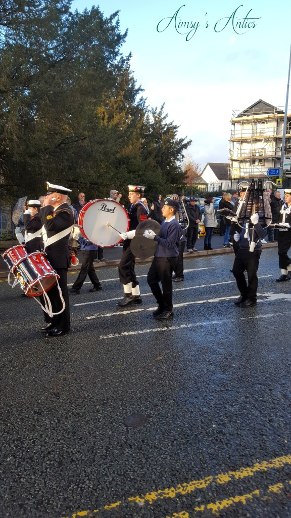 Remembrance parade in Bowness-on-Windermere with cadets playing drums and cymbals.