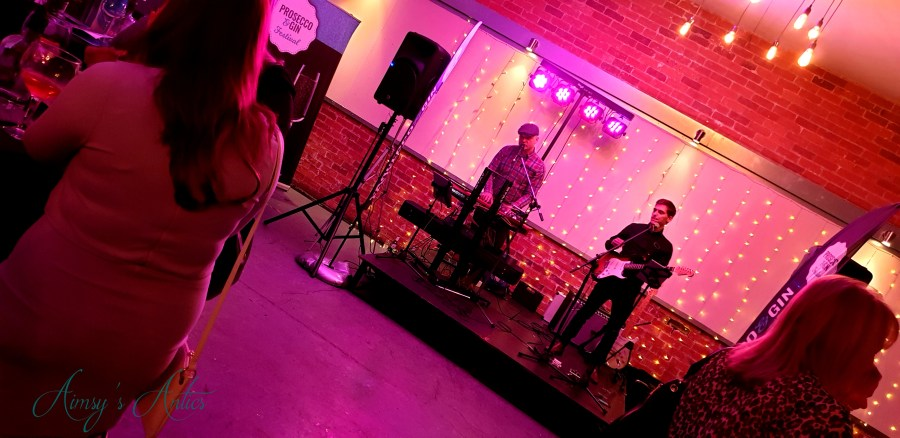 Two-man band playing on stage at new Craven Hall