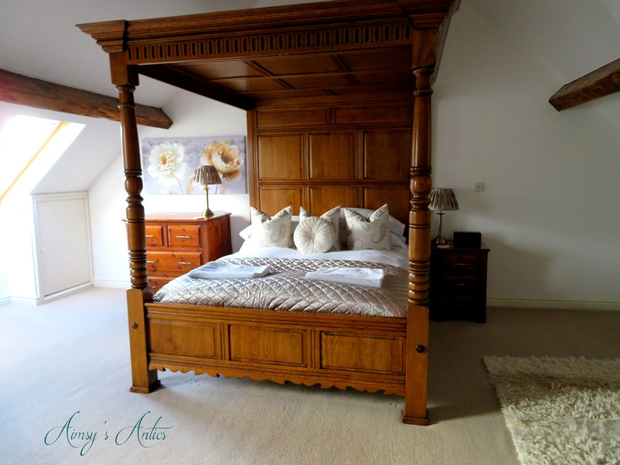 Four-poster King size bed at the Castle View town House, Conwy