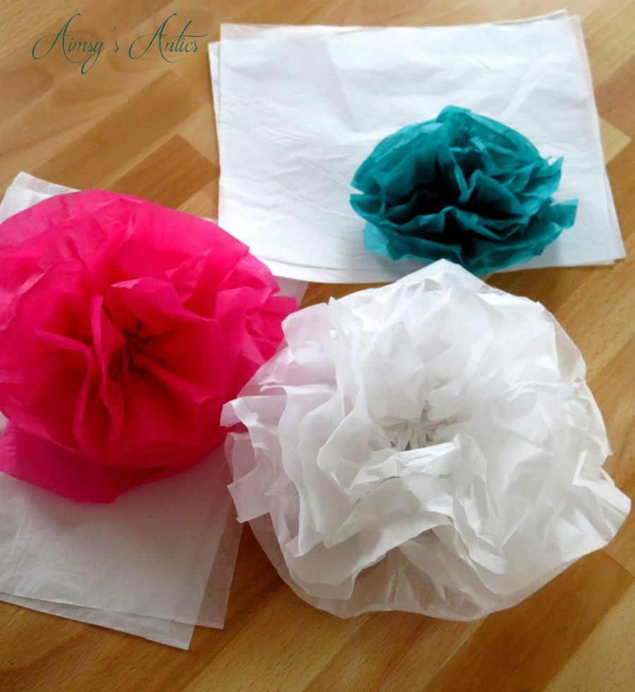 Tissue paper flowers, 1 white, 1 pink and 1 teal in colour