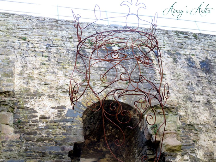 Metal structure of the King's head floating at Conwy Castle.