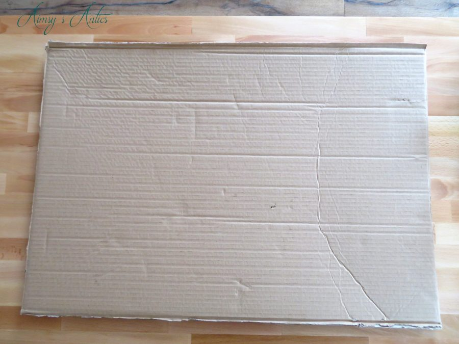 Piece of cardboard on a wooden counter.