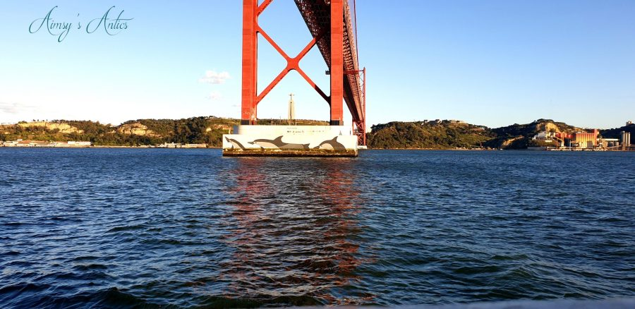 View of the artwork at the bottom of 25 de Abril Bridge - Killer whales.