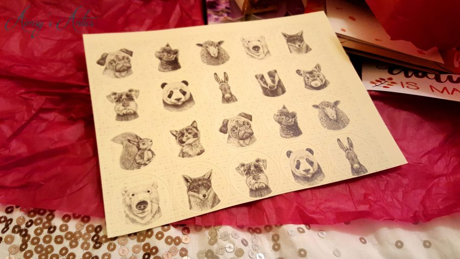 Round stickers with drawn animals on them