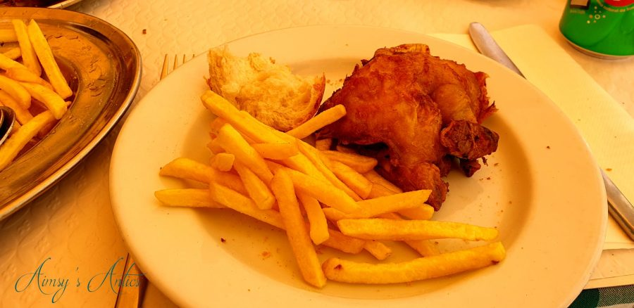 Chicken and chips on a plate at Bonjardim, Lisbon