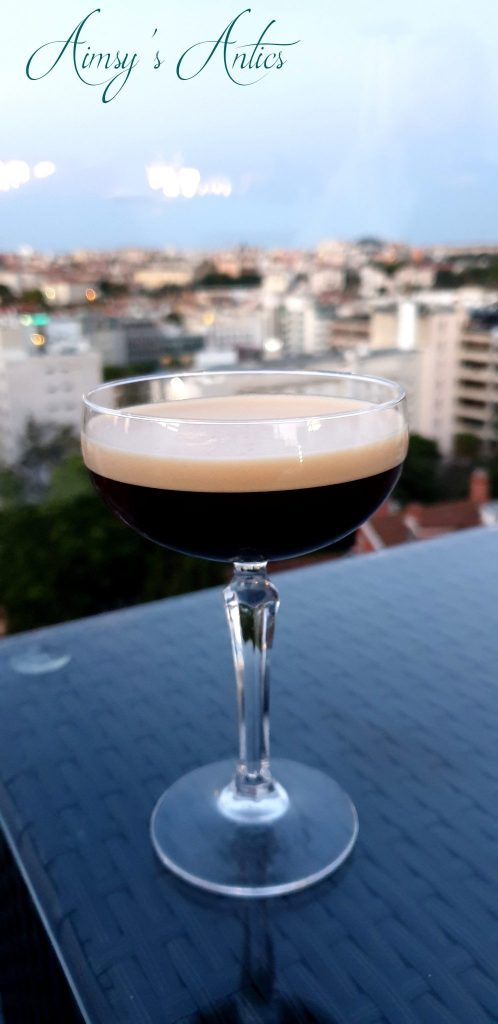 Espresso Martini with the view of Lisbon behind