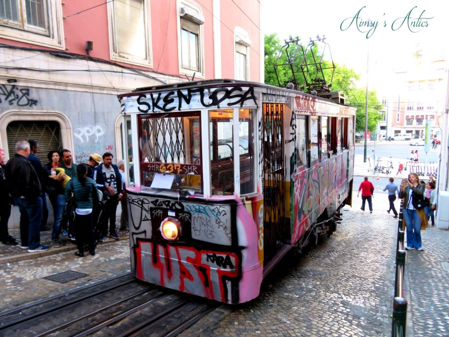 Tram covered in graffiti in Lisbon