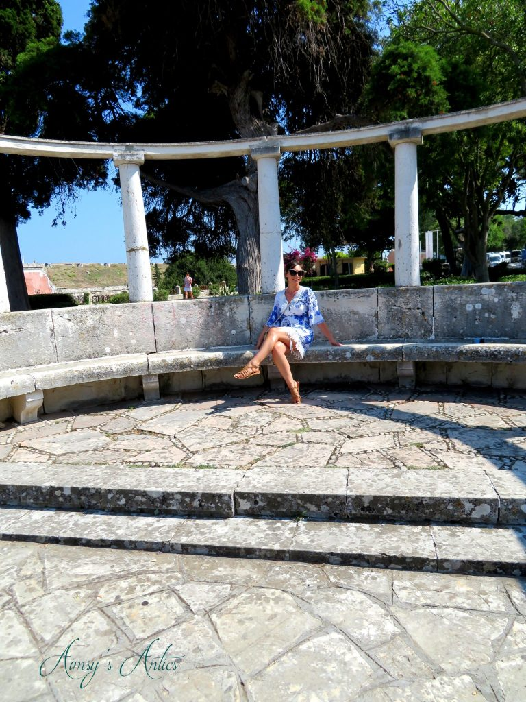 Woman sitting in the Spianada, Corfu Town
