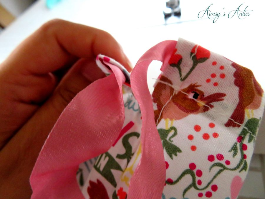 Ribbon out of the openings of a drawstring bag