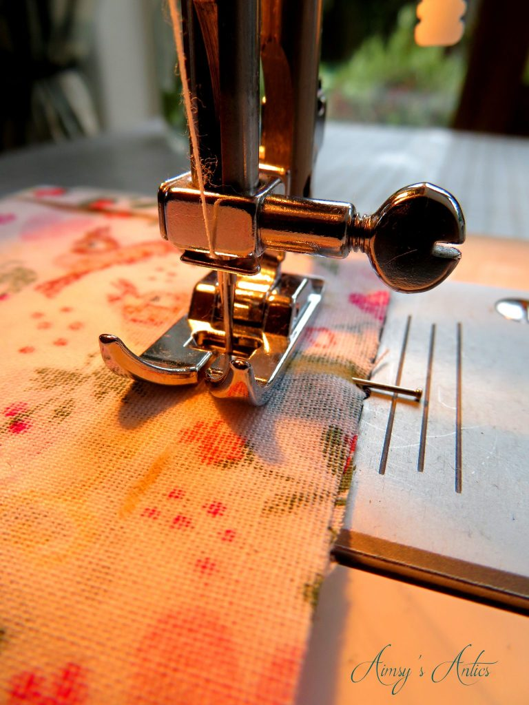 Close up of sewing machine needle sewing