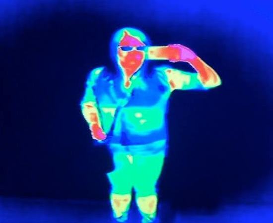 A false-color image showing the light a human body emits in the infrared