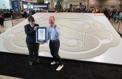 Michael McNally,†LEGO†Group Senior Director of Brand Relations, right, pumps his fist as he receives a certificate of achievement from GUINNESS WORLD RECORDS Adjudicator, Christina Flounders Colon, at†the Star Wars†Celebration at McCormick Place in Chicago, April 11, 2019. Flounders Colon adjudicated the title for the largest display of†LEGO†Star Wars†minifigures for the companyís installation of 36,440†LEGO†stormtrooper minifigures (Alex Garcia/AP Images for The†LEGO†Group)