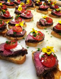 Filet of Beef Crostini with Caramelized Onions, Horseradish and Tomato