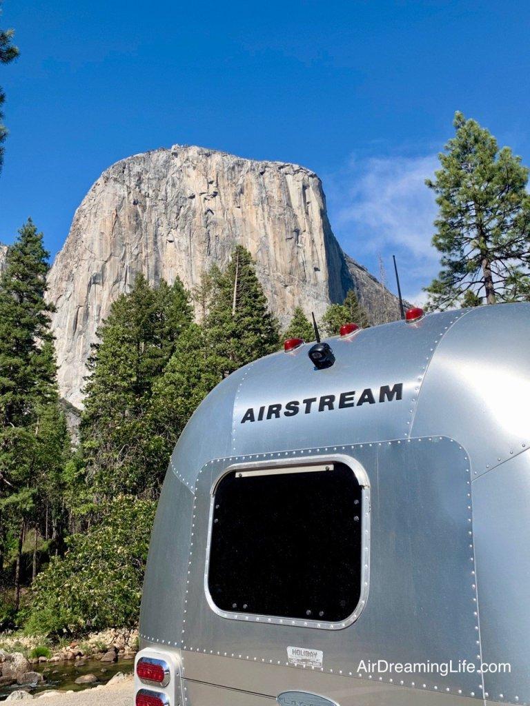Airstream trailer parked below El Capitan in Yosemite