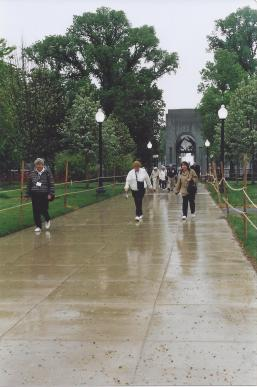 Delegates on rainy walkway