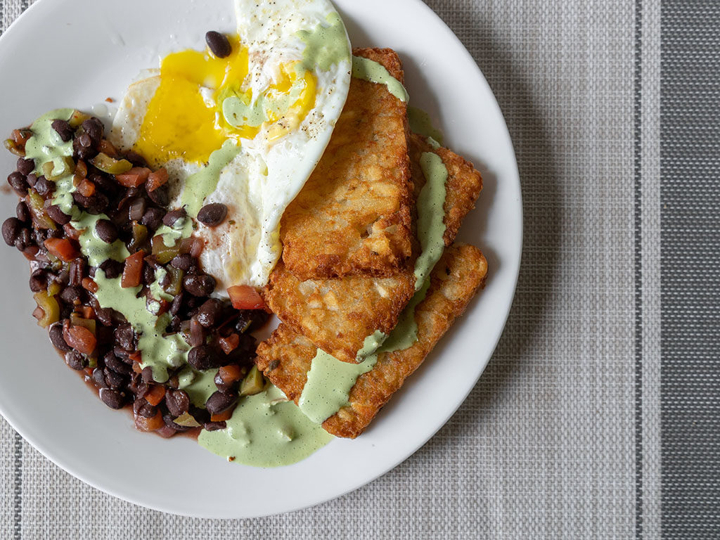 Walmart hash browns with cilantro ranch sauce, black beans and eggs