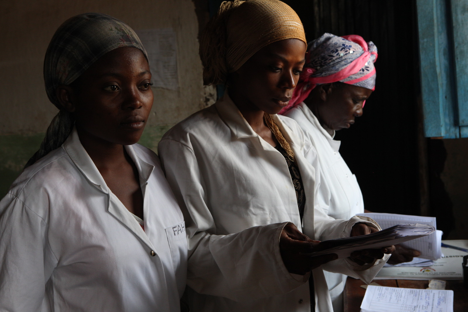 Congolese doctor reviewing case at a women's health center in the DRC.