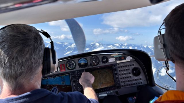 Here we're adjusting the autopilot to turn a a bit more to the left while passing over Snoqualmie Pass in Washington state. Katie Bailey photo
