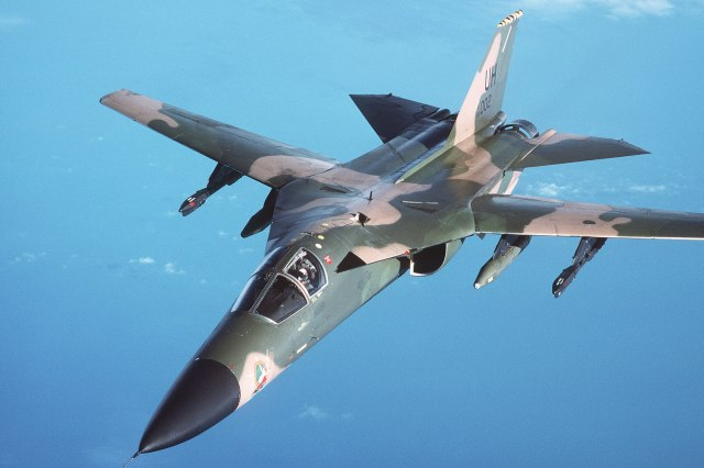 An air-to-air left front view of an F-111 aircraft during a refueling mission over the North Sea DF-ST-89-03609.jpg