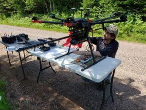 A researcher with a drone