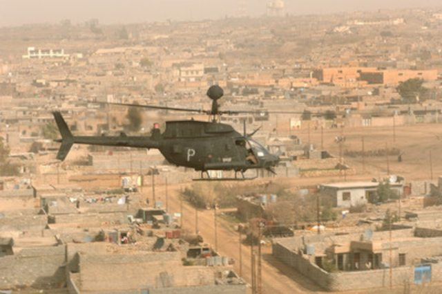 A U.S. Army OH-58D Kiowa helicopter from the 3rd Armored Cavalry Regiment conducts a combat air patrol over the city of Tall Afar, Iraq, on Feb. 9, 2006.