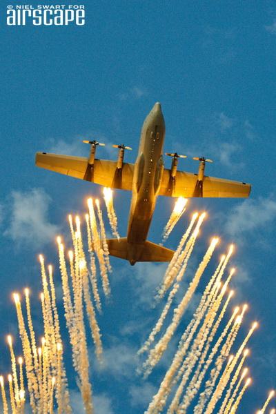 A superb shot of a SAAF C-130BZ, deploying a cascade of flares over AAD2016. (© Niel Swart)