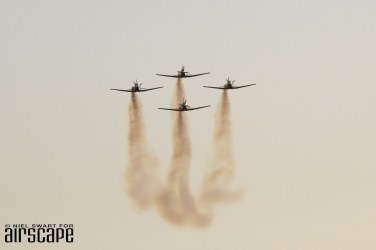 Smoke on! Adding to the growing haze of the Saturday afternoon, the SAAF Silver Falcons display team on approach. (© Niel Swart)