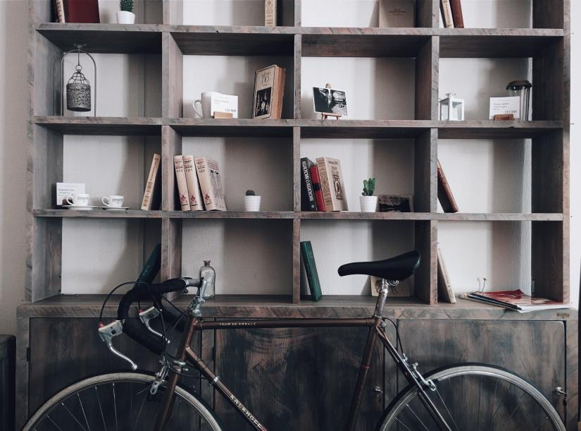 bicycle leaning on an organized shelf