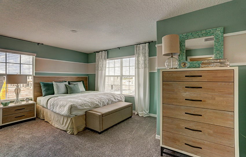 Royale Palm model bedroom located at ChampionsGate