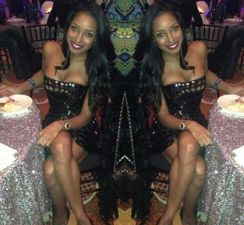 African temptress from Nigeria in hot mini dress atends a cocktail party