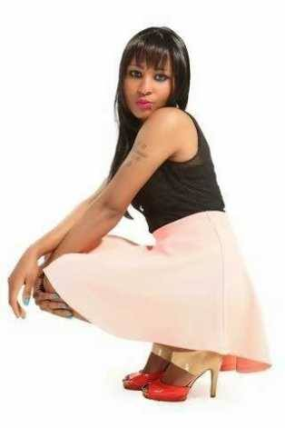 An attractive Kenyan woman in squatting pose