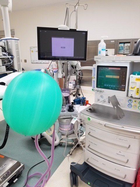 picture of an anesthesia machine with Ventilation bag left overinflated during a machine check, with 10 liter flow and the pop-off set at 20mmHg demonstrating barotrauma risk