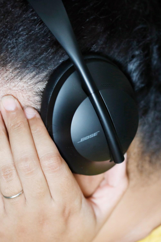 woman wearing bose 700 headphones