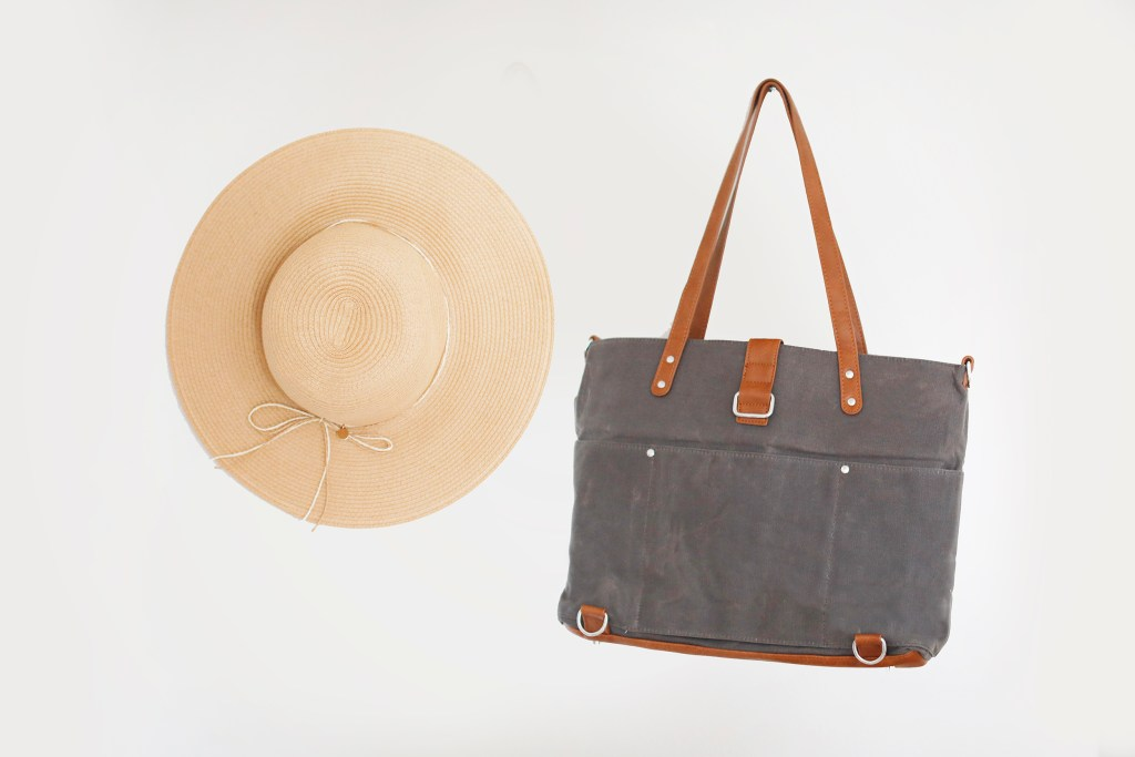 momkindness canvas tote next to hat
