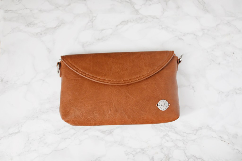 momkindness bag diaper clutch