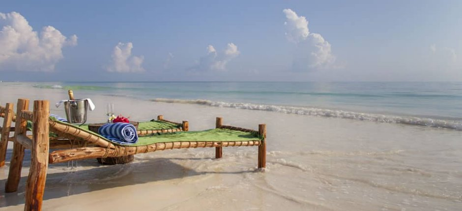 Sunbeds and champagne on the beach at Kisiwa in Zanzibar