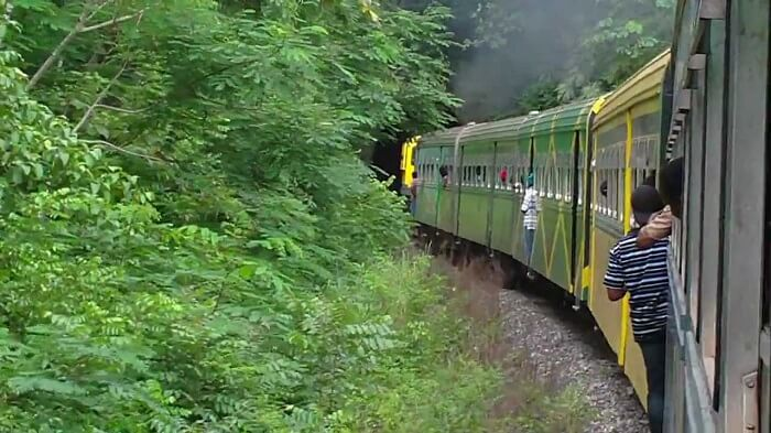 People riding a train in Jamaica