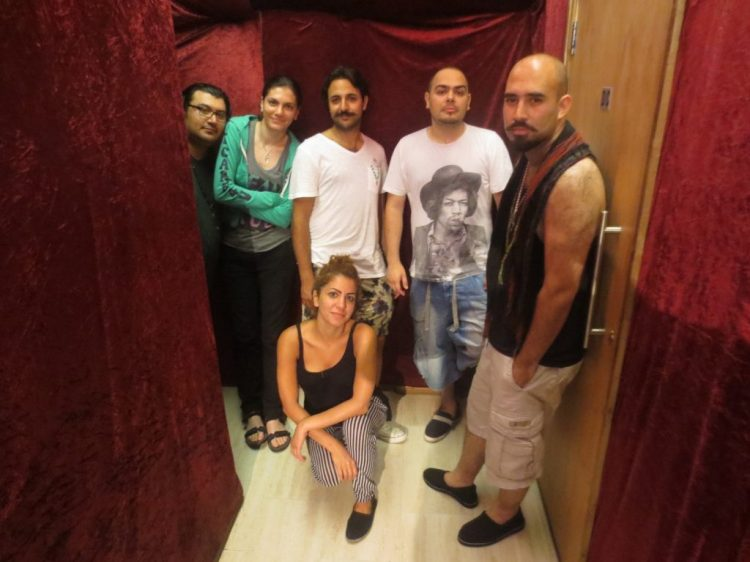 Ajam band's five formal members, not including a rotating cast of Iranian musicians who perform on recordings and tours. Pictured here (from right to left) are current performing members: Amin Ajami, Nari-Man, Parham Ajami, Shohreh Khatoon, Sara Fotros, and Arash Fayyazi. Zartosht Zafari, not pictured here, is also a member. (Photo: Kamyar Jarahzadeh)
