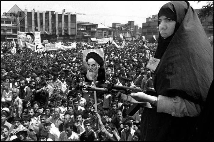 Woman guards crowds in Tehran in 1979. Photo: Alfred Yaghobzadeh