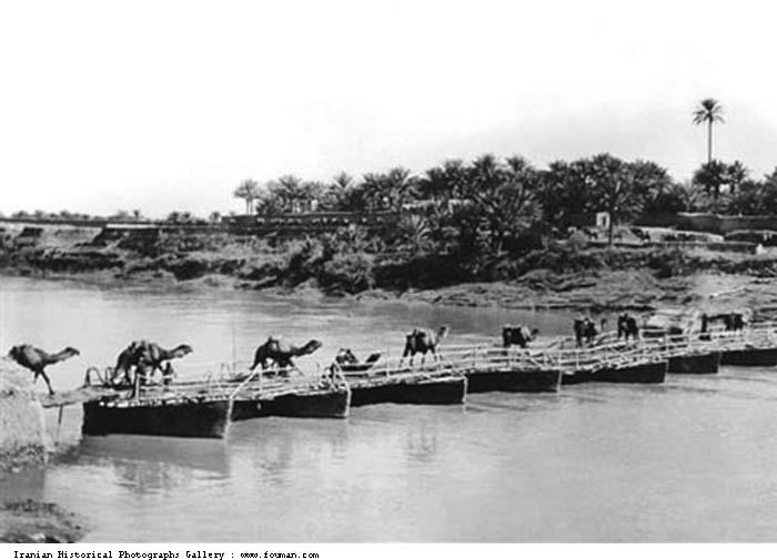 Camel caravan on the pontoon bridge on Bahmanshir River leading to Abadan, 1910s or 20s.