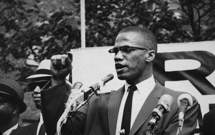 American civil rights leader Malcolm X (1925 - 1965)  at an outdoor rally, probably in New York City.  (Photo by Bob Parent/Hulton Archive/Getty Images)