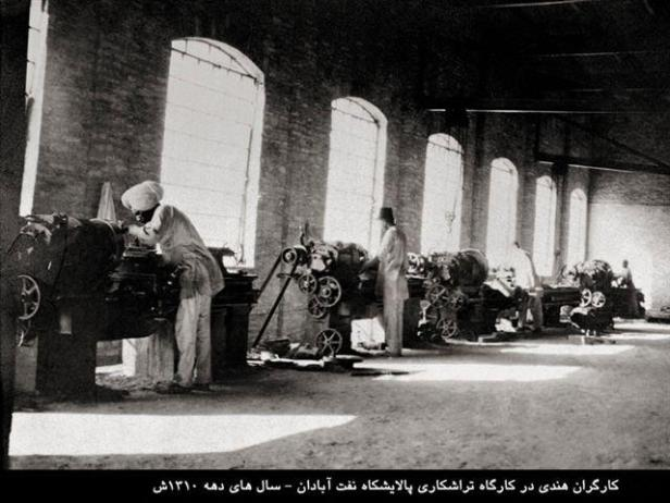 Indian workers in a turning workshop, 1930s.